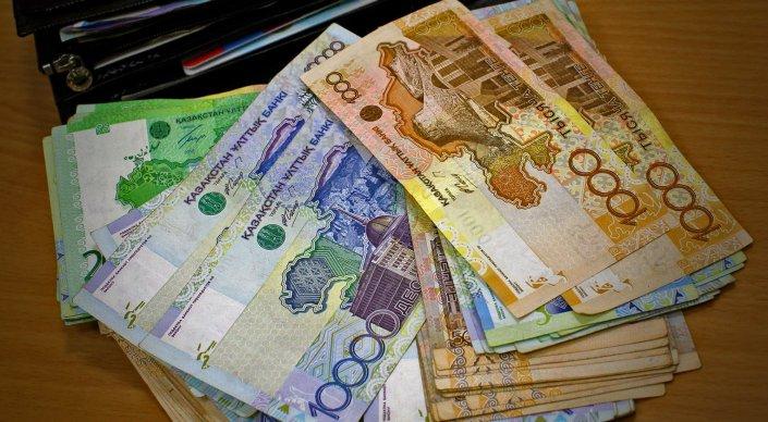 Курс тенге к доллару может достигнуть 192 тенге к концу 2015 года - аналитики