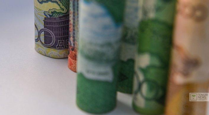 Курс нацвалюты может укрепиться до 310 тенге за доллар до конца марта - экс ...