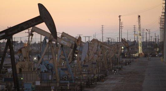 Акишев объяснил странную реакцию тенге на рост цен на нефть