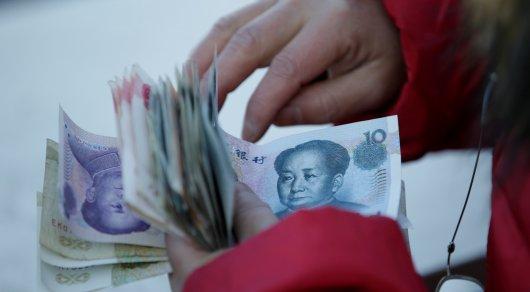 Moody's снизило кредитный рейтинг Китая доА1
