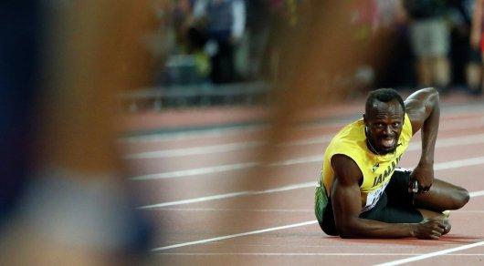 Драма на весь мир: Болт не смог финишировать в последнем забеге в карьере